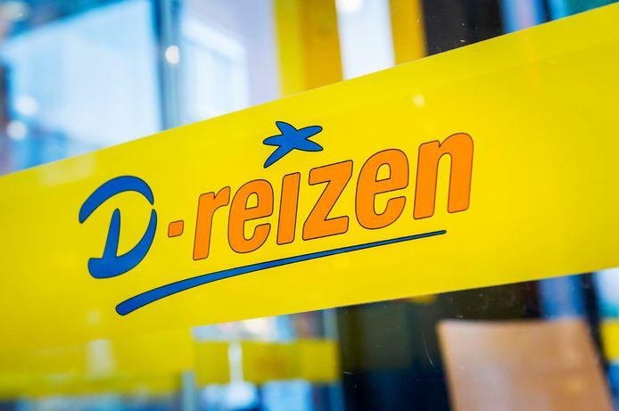 Het logo van D-reizen van een filiaal in Hoofddorp.