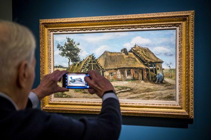Paysanne devant une chaumière van Vincent van Gogh