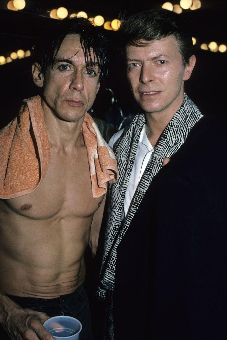 Iggy Pop en David Bowie backstage na Iggy's concert in de Ritz, New York, 1986. Beeld Getty