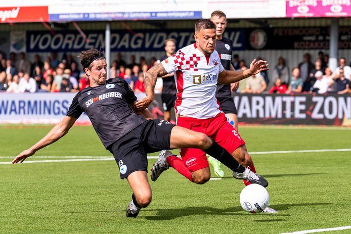 WERKENDAM, Netherlands, 11-09-2021, football, , Jack's League Dutch Tweede Divisie , season 2021 / 2022,  during the match Kozakken Boys - Spakenburg, Spakenburg player Frank Schilder (L), Kozakken boys player Mark Veenhoven (R)