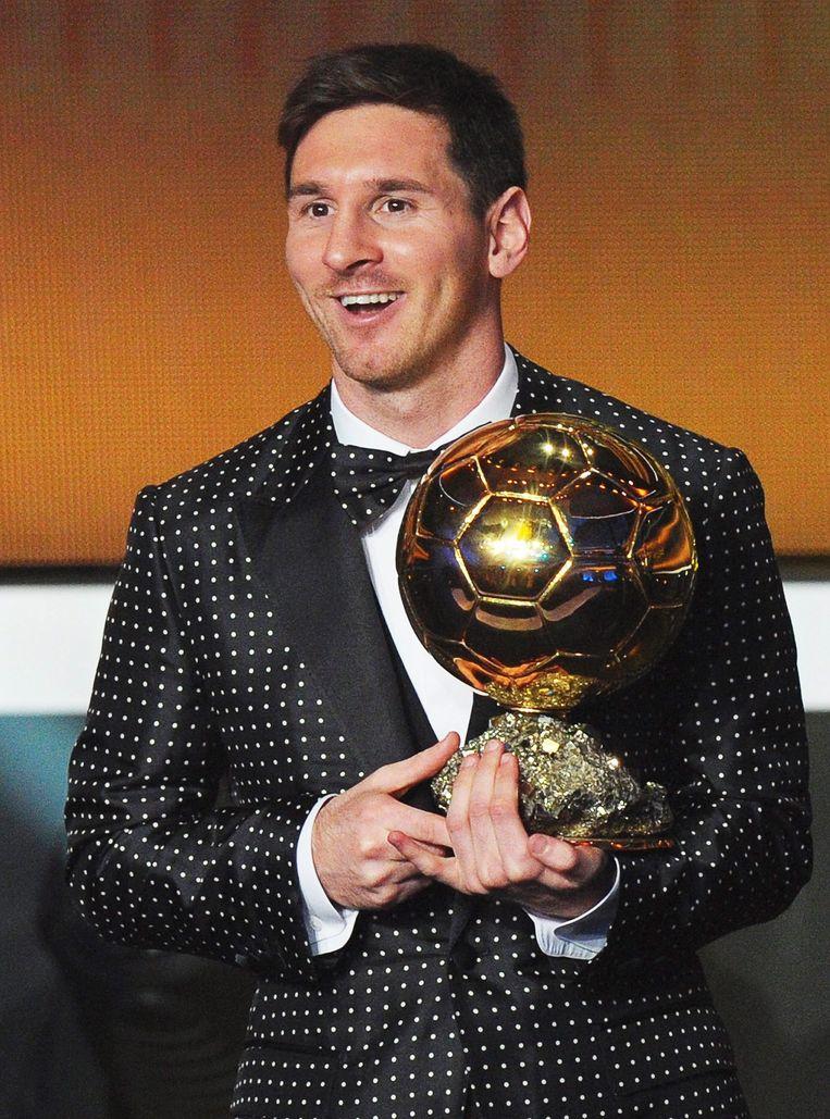 Lionel Messi met de Ballon d'Or. Beeld EPA