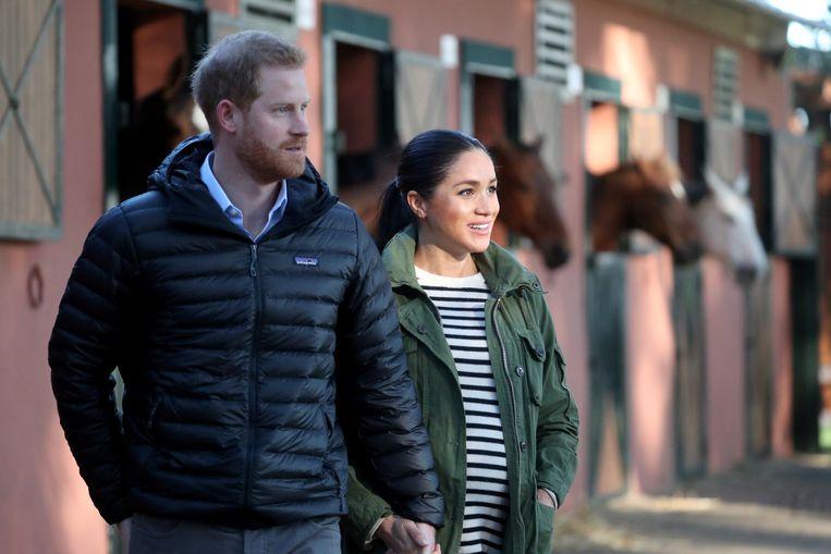 Prins Harry en echtgenote Meghan, op de foto nog zwanger.