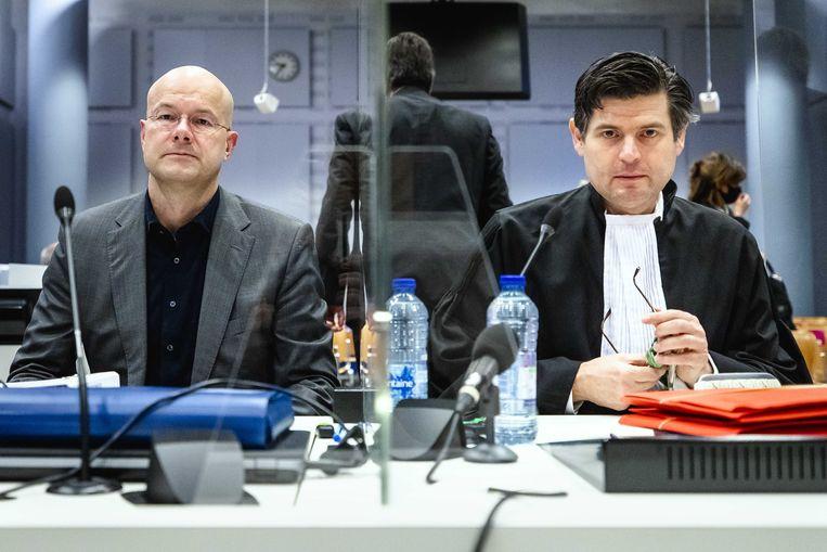 Directeur Donald Pols (L) en advocaat Roger Cox (R) van Milieudefensie in de rechtbank tijdens de tweede hoorzitting in de klimaatzaak tegen Shell Beeld ANP