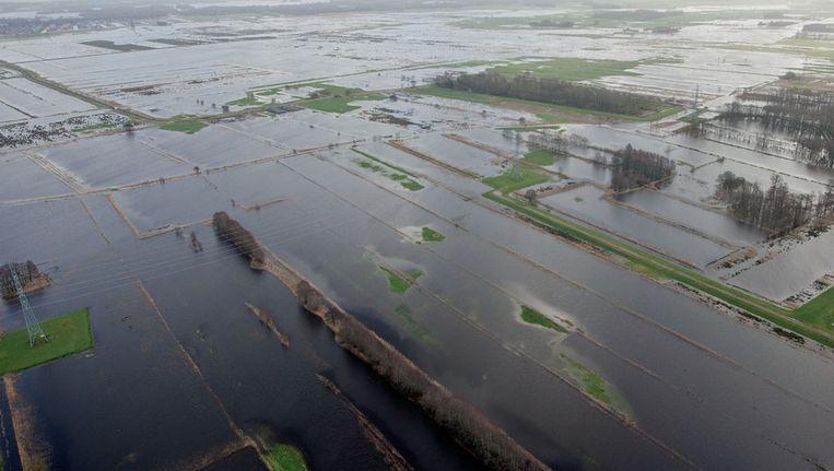 Wateroverlast in een gebied ten zuiden van de stad Groningen. © ANP Beeld null