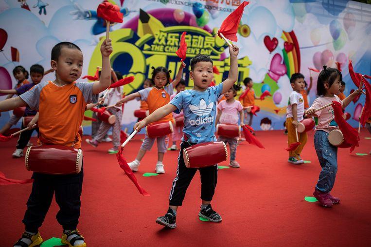 Oefenen voor de nationale kinderdag in Wuhan. Beeld Getty