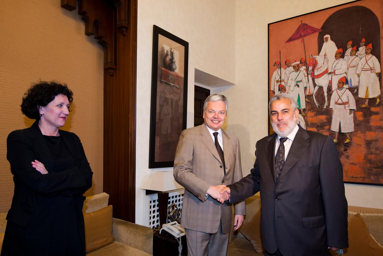 Minister van Justitie Annemie Turtelboom ging in 2012 op bezoek bij de Marokkaanse premier Abdelilah Benkirane, maar kreeg geen hand. Hij dacht dat ze de tolk was van minister Didier Reynders. Beeld BELGA
