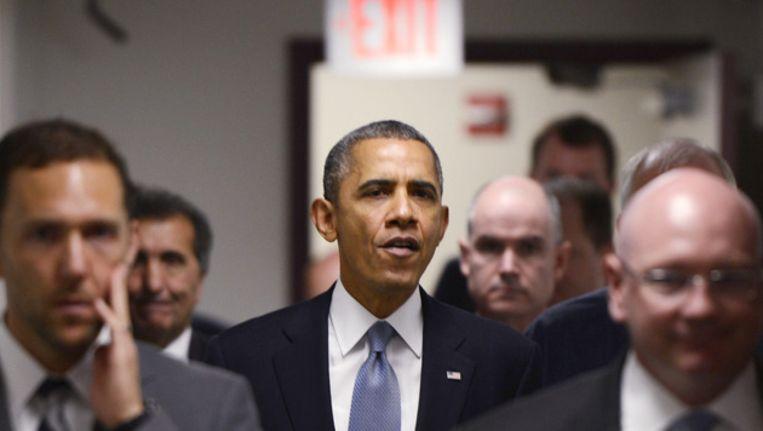 Obama maandagmiddag op weg naar een vergadering omtrent de shutdown Beeld getty