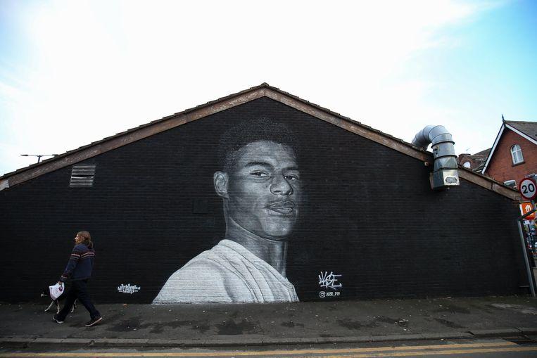 Rashford wordt geëerd met een mural van street artist Akse, in Withington. Beeld PhotoNews