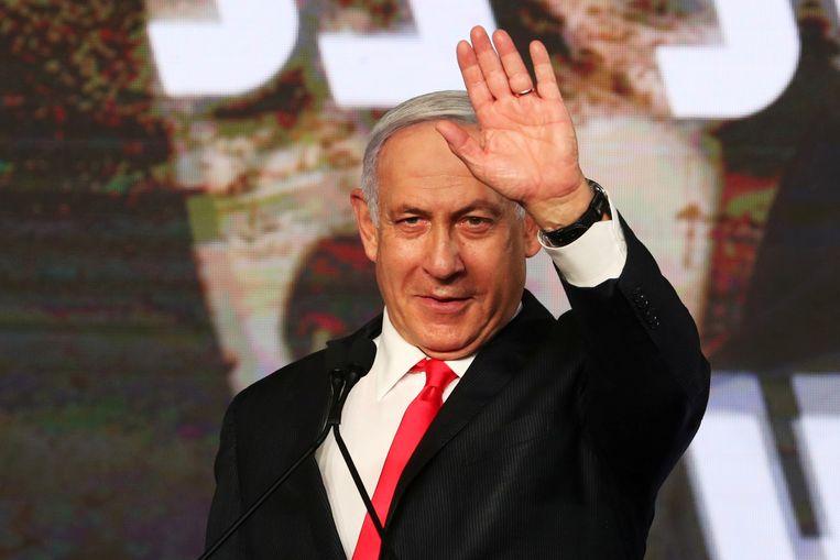 Benjamin Netanyahu na afloop van een campagnetoespraak. Beeld REUTERS