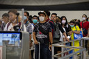 As Coronavirus spreads travelers arriving wait in line at immigration wear masks at Suvarnabhumi International airport  in Bangkok, Thailand on February10, 2020.  The Coronavirus has effected more than 40,500 people in Asia, according to health officials with approximately 910 people who have died in mainland China. The fatality rate of the virus is probably less than 3 percent which is less than SARS. The virus is now spreading way outside of the Asian region with 12 cases confirmed in the United States.  (Photo by Paula Bronstein/Getty Images )