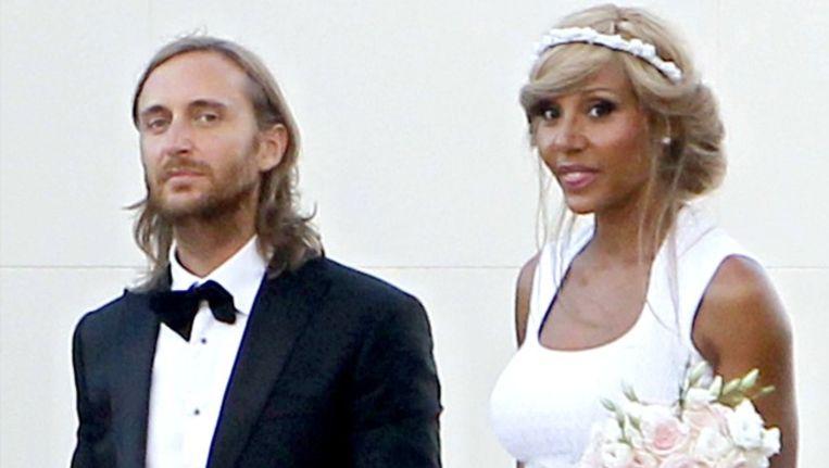 David Guetta en zijn vrouw Cathy beloven elkaar twintig jaar na hun eerste huwelijk opnieuw hun eeuwige trouw. Beeld PHOTO_NEWS