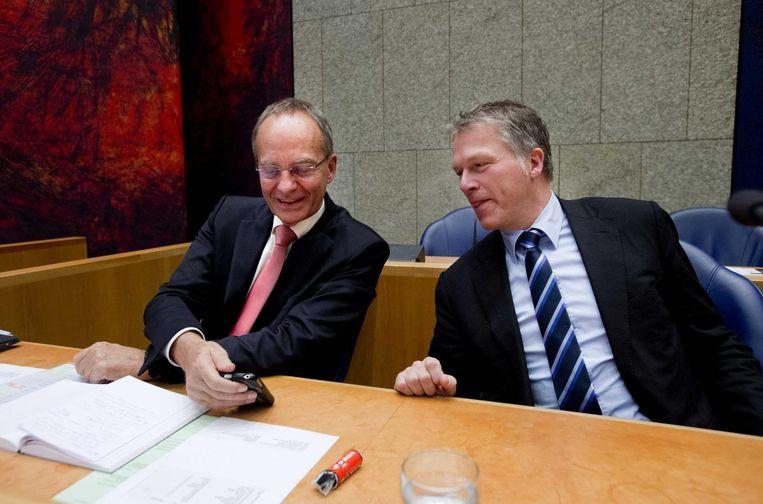 Toenmalig informateurs Henk Kamp (VVD) en Wouter Bos (PvdA) in 2012. Beeld anp