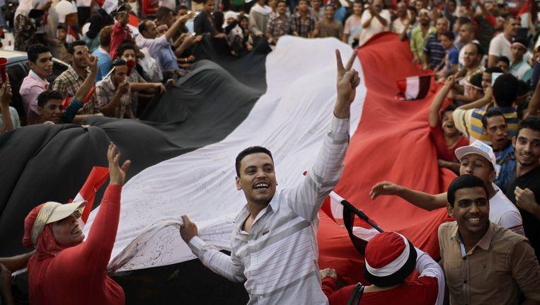 Feest in de straten van Caïro bij de opening van het Suezkanaal, maar mensenrechten zouden niet gerespecteerd worden. Beeld © ap