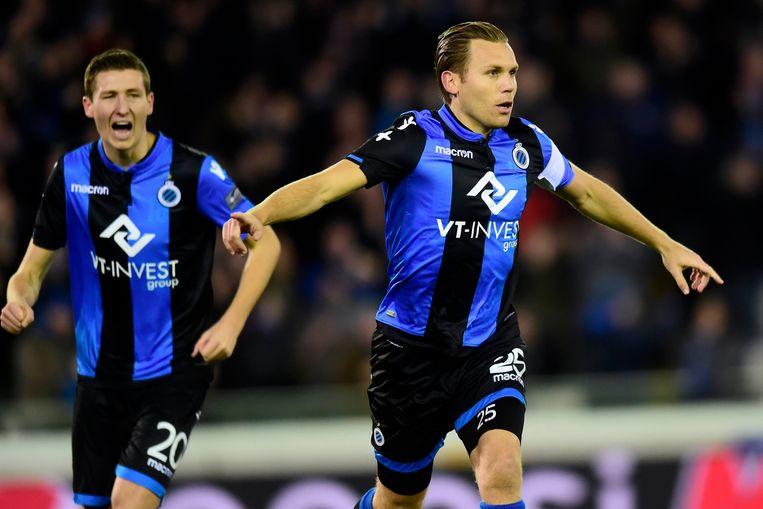 Ruud Vormer viert de tweede goal van de avond. Amper 3 minuten eerder tekende Hans Vanaken (l.) voor de openingstreffer. Beeld Photo News