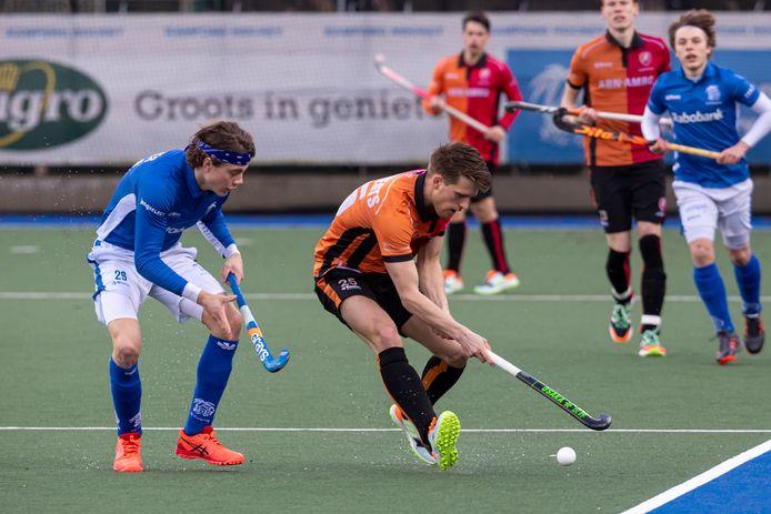 Bram Huijbregts van Oranje-Rood in de wedstrijd tegen Kampong.