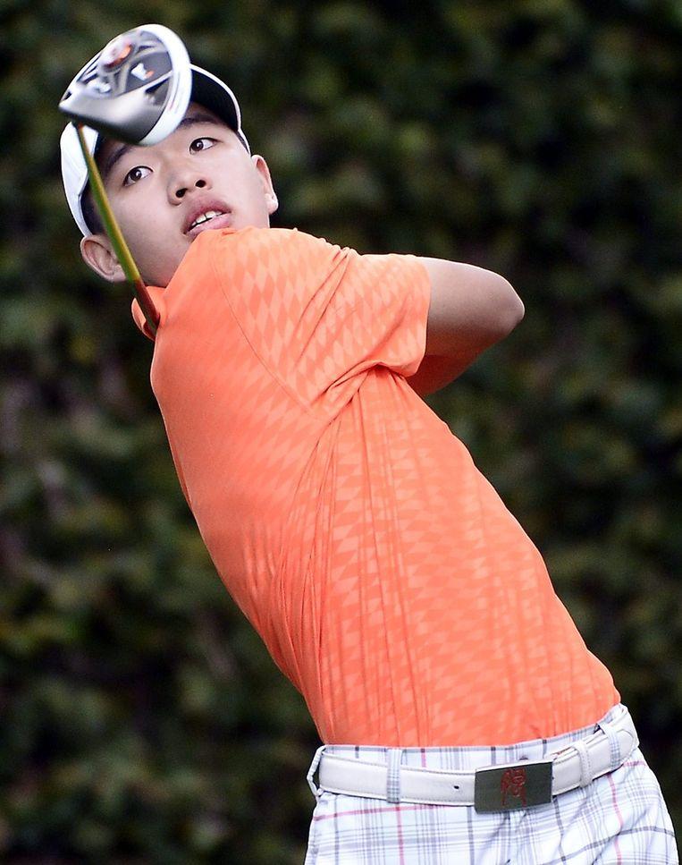 Guan Tianlang, de 14-jarige golfer uit China. Beeld epa