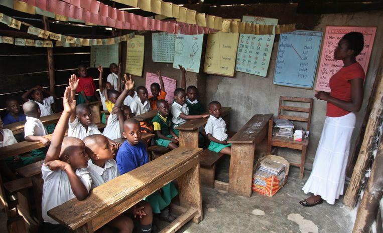 Archiefbeeld: Kinderen op de schoolbanken in Oeganda.  Beeld AP