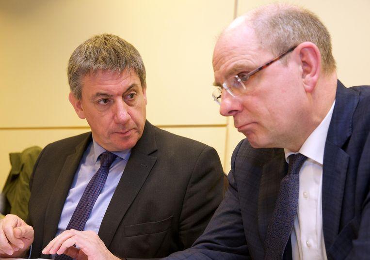 Binnenlandminister Jan Jambon en justitieminister Koen Geens. Beeld BELGA