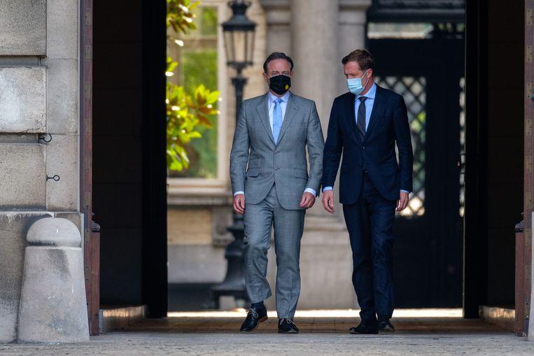 Bart De Wever en Paul Magnette, zaterdag na hun bezoek aan de koning. Beeld BELGA