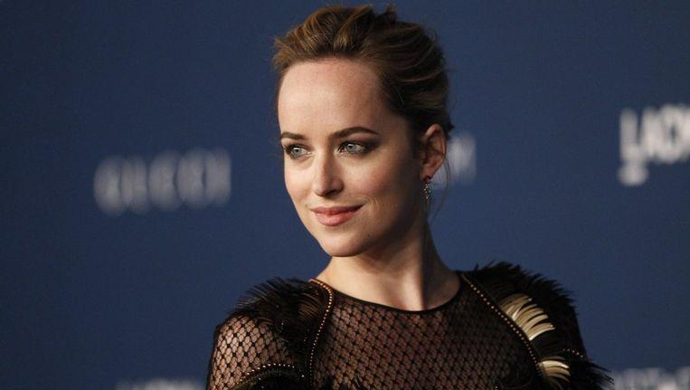 De 24-jarige Dakota Johnson speelt de rol van Anastasia Steele, een werkneemster van Grey die zich graag tot de kinky seks laat verleiden. Beeld REUTERS