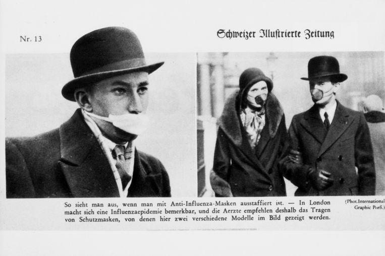 Mondkapjes tegen de Spaanse griep in Groot-Brittannië in 1918.  Beeld Getty Images