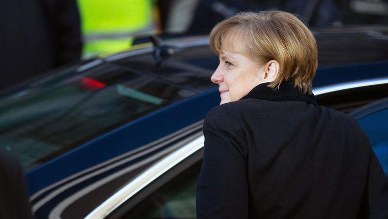 Angela Merkel bij aankomst voor de coalitie-onderhandelingen. Beeld EPA