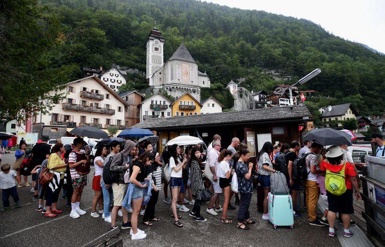 Toeristen in Hallstatt. Beeld Reuters