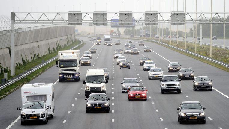 Automobilisten op de rijksweg A2. Beeld null