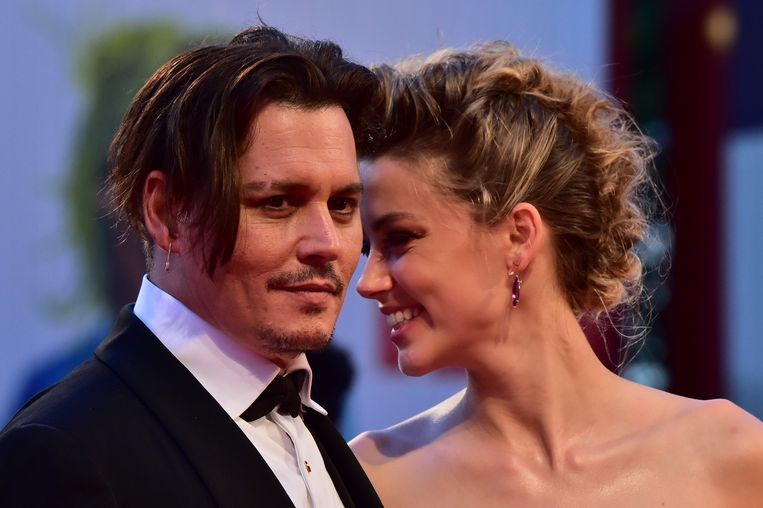 Johnny Depp en Amber Heard, hier tijdens hun huwelijk in 2015. Beeld AFP