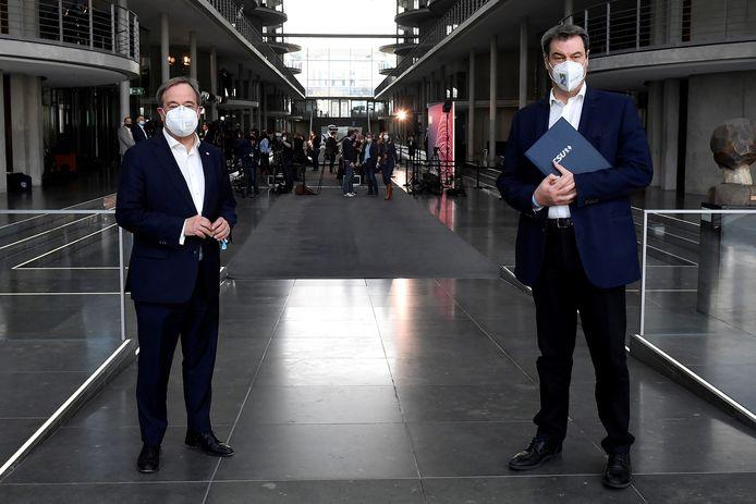 Armin Laschet en Markus Söder zondag in Berlijn.