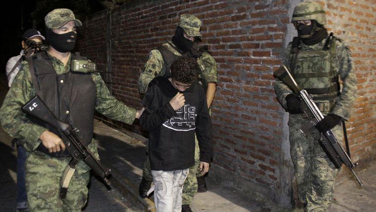 Edgar Jimenez Lugo tijdens de arrestatie vorig jaar. Beeld ap