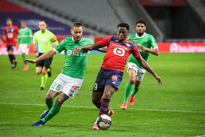 Jonathan David (rechts) geraakte met Lille niet voorbij Saint-Etienne en is nog geen kampioen.