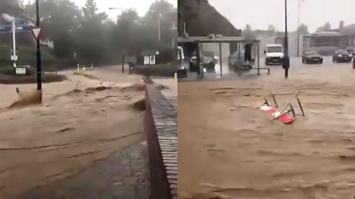 Hevige wateroverlast in Zuid-Limburg: op beelden is te zien hoe hekken en fietsen door de stroom worden meegesleurd.