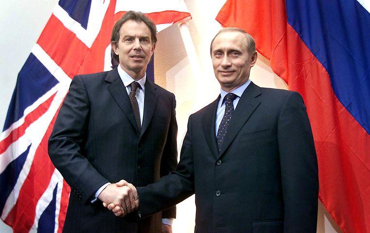 Poetin bij Brits premier Blair (2000). 'In zijn eerste jaar is hij vier keer naar Londen geweest. Dat was een duidelijke boodschap aan Europa, aan wereldleiders. Hij zei: ik ben een van jullie.' Beeld AFP