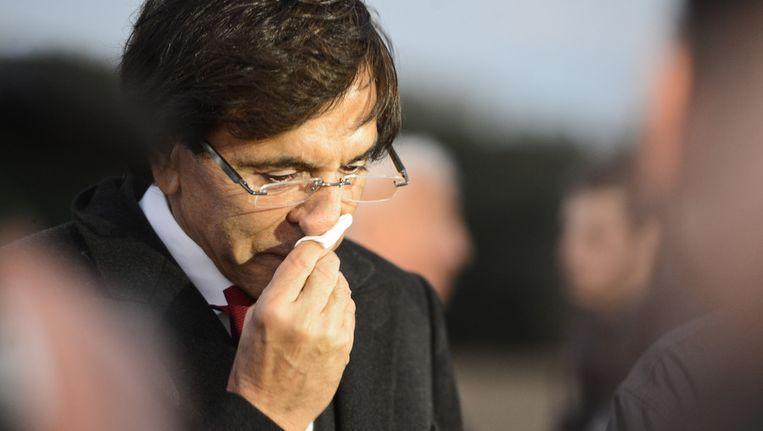 Premier Elio Di Rupo op de site van de crash. Beeld BELGA