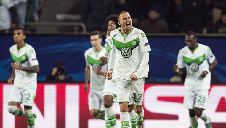 Wolfsburg-spits Bas Dost viert de 1-0 Beeld afp
