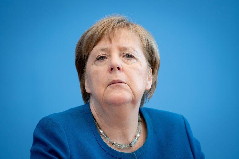 Angela Merkel roept op tot solidariteit en gezond verstand. Beeld Kay Nietfeld/dpa