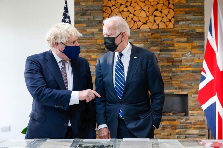 De Britse premier Boris Johnson en Amerikaanse president Joe Biden ontmoetten elkaar donderdag voor het eerst, aan de vooravond van de G7-top.  Beeld EPA