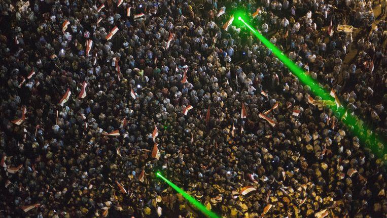 Een deel van de menigte die zich zaterdag op het Tahrirplein had verzameld. Beeld ap