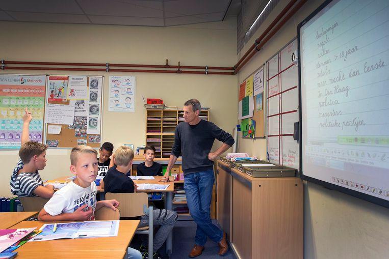 Er staan steeds meer Vlaamse leerkrachten voor Nederlandse klassen. Beeld Hollandse Hoogte / Werry Crone