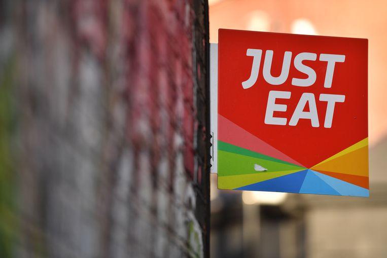 Een bordje van Just East aan de gevel van een restaurant in Londen. Beeld AFP