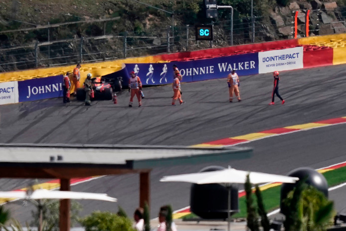 Red Bull Racing's Dutch driver Max Verstappen (R) walks near the circuit after crashing with his car into a wall after the start of the Belgian Formula One Grand Prix at the Spa-Francorchamps circuit in Spa on September 1, 2019. (Photo by Kenzo TRIBOUILLARD / AFP)