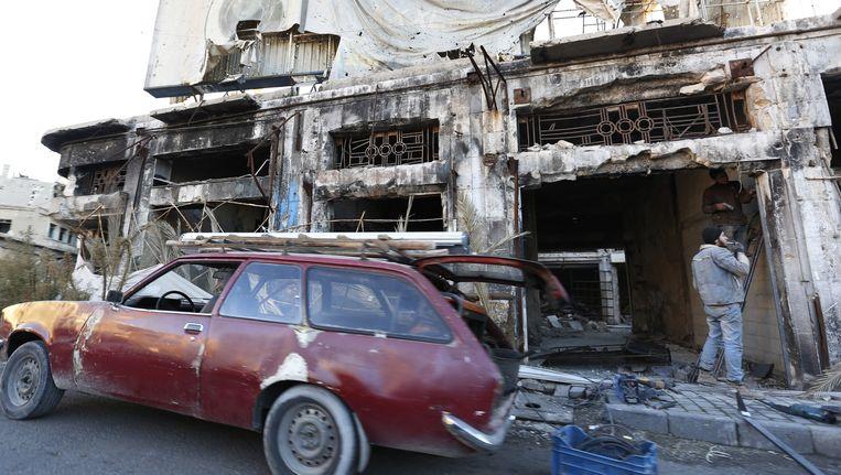 Archieffoto: een vernield gebouw in de stad Homs Beeld AP