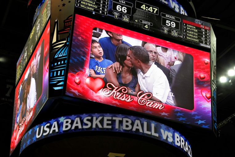 U.S. President Barack Obama and first lady Michelle Obama are shown kissing on the
