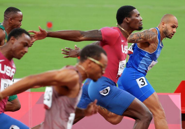 De Italiaan Lamont Marcell Jacobs (rechts) wint de 100 meter. Beeld EPA