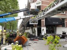 Twee gewonden na beknelling tussen verhuislift en raam in Kralingen