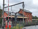 De overweg aan het station van Kalmthout in het centrum van de gemeente.