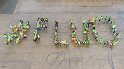 Fluodag voor meer zichtbaarheid in het verkeer: 150 leerlingen stunten met kleurrijke dronefoto