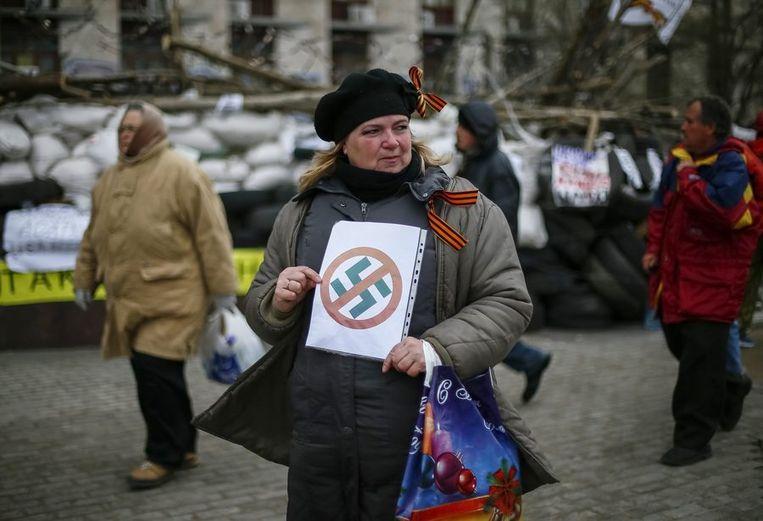 Pro-Russische demonstrant in Donetsk Beeld reuters