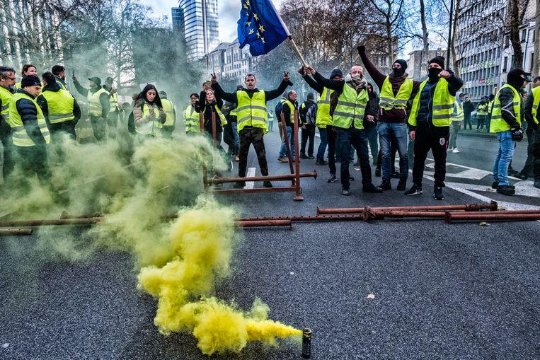 Geel sfeertje tijdens de protesten in Brussel. Beeld Tim Dirven